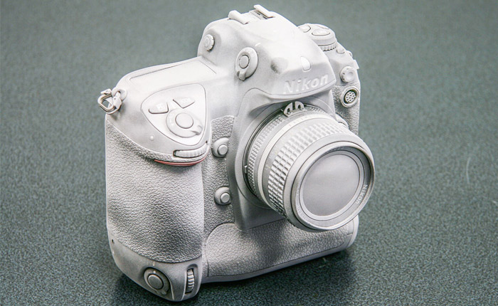 Camera covered in AESUB 3D scanning spray