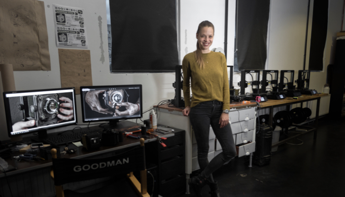 Dora Goodman alongside Anycubic i3 Mega printers in her workshop.