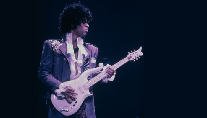 Prince playing Cloud guitar on stage
