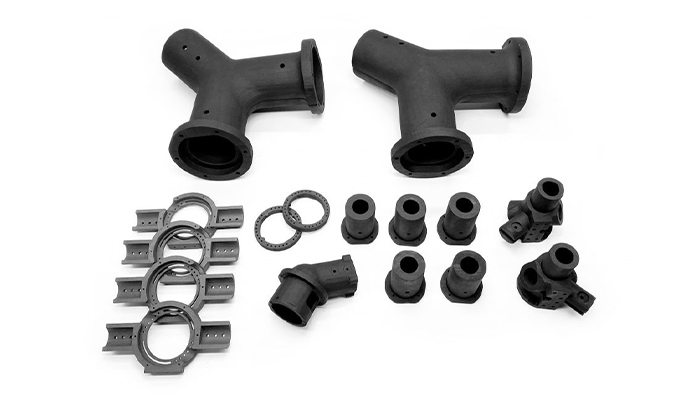3D printed parts with PEEK and PA 12 in carbon fibers (Photo credits: Ricoh 3D)